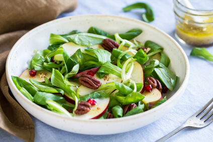 Mâche with Apple, Pomegranate and Pecan salad by vinaigrette
